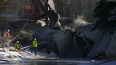 front end loader : Emergency crew cleaning up a train derailment Stock Footage