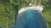 turkus : Scenic aerial view of beautiful bay with beach, white sand, azure ocean water in tropical island. View from above nature landscape of lagoon coast. Summer vacation and travel concept. Beauty of nature Wideo