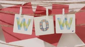 lekcja : WOW word collected by child hand from paper cards with color letters on red background. Text message, language education concept.