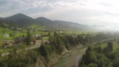 roof : Flight over rural areas with river in mountains .Aerial shot Stock Footage