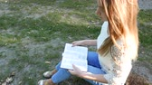 sólido : 4k. Bible and attractive girl in sunny park. Christian prayer team shot, top view Stock Footage