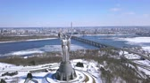 4K. Kyiv city - capital of Ukraine.MotherMotherland Soviet time monument. Aerial winter shot Stockvideo