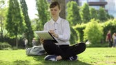 chilling : Young business womanstudent doing her tasks in the park. Stock Footage
