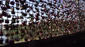 fence : Concept of happy couple, love friendship forever. Many different color closed metal padlocks with heart hanging on bridge fence of Mohnetalsperre Dam, Mohnesee Lake Water Reservoir, Germany