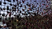 loyalty : Concept of happy couple, love friendship forever, Background. Many closed metal padlocks with heart hanging on bridge fence of Mohnetalsperre Dam, Mohnesee Lake Water Reservoir, Germany