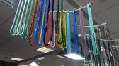 Different colorful stone necklaces on a hanger