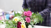 Female florist arranging flowers in flower shop