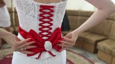 preparations : bride corset tie on the back of a red ribbon and bow