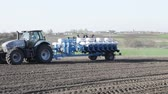 fieldwork : SMELA, CHERKASSKAYAUKRAINE - APRIL 10 2013: tractor leaving the field with a drill on April 10 in Smela