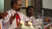 interior : PARVORIM, GOAINDIA - FABRUARY 01 2014:three priests held a wedding ceremony in the Catholic Church in India on Fabruary 1 in Parvorim. Stock Footage