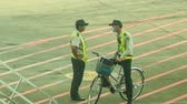 cartn corrugado : HO CHI MINH CITY, HO CHI MINH  VIETNAM - MARCH 21, 2016: Airport workers in special uniform and caps stand at bike and talk on airfield on March 21 in Ho chi minh city Stock Footage