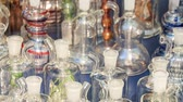 cartn corrugado : closeup different colorful glass hookahs on mobile counter cart in China town in Kuala Lumpur Stock Footage