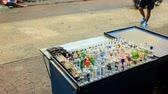cartn corrugado : closeup mobile counter cart with hookah glass facilities in busy street of China Town in Kuala Lumpur