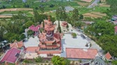 lawn : Drone shows backside of a traditional temple