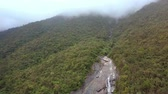 fast river : amazing aerial view fast mountain canyon part along tropical woods and deep fog on hills