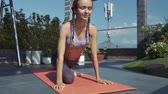 çatı katı : closeup of beautiful smiling girl holding yoga position with closed eyes at luxury rest terrace on sunny day