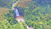 maravilha : drone flies to waterfall streaming from clayee river among jungle
