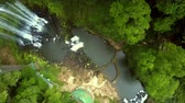 turns : flycam turns round above waterfall running into gorge