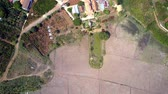 arando : high flight over plowed fields plantations and houses