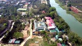 буддист : bird eye flight Buddhist complex on river bank Стоковые видеозаписи