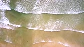 amador : aerial long wide foamy ocean waves roll on beach Stock Footage