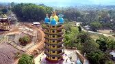 asian architecture : upper view multistorey pagoda with domes on building site