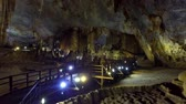 впечатляющий : colourful lamps illuminate Paradise Cave hall