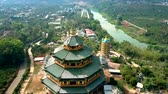 tremendous : aerial picture tremendous temple on river bank in Vietnam Stock Footage