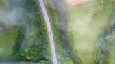 протяжение : flycam descends to road with traffic among green landscape