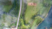 montanhoso : upper view green hilly farm land between road and river