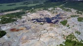 bizarre landscape : high general view clay quarry area with pond