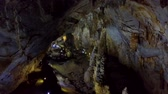 geology : flashlight beam runs along mystical huge cave bottom