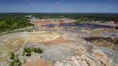 bizarre landscape : flight above boundless clay quarry landscape with pond Stock Footage