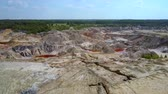 abandonar : aerial space landscape of abandoned clay pit under blue sky Stock Footage
