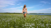 šortky : butterflies fly around girl walking on buckwheat field