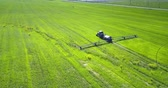 pesticide : aerial view tractor trailer drives making tracks on field