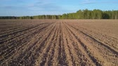 zbytek : motion over plowed field with residues on surface to forest