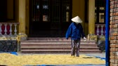 терракота : laborer in hat walks and mixes dry yellow clay by bare feet
