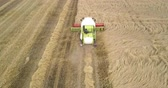 farming equipment : upper picture combine gathers crop leaving dust trace