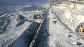 minerals : bird eye view electric train pulls railway ore cars on pit
