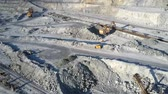 tyumen : excavator loads platforms for rock transportation on pit Stock Footage