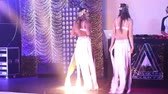 girls in white costumes dance on night club stage