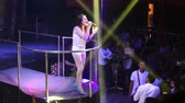 music concert : asian girl pop star in top sings clubbers have good time