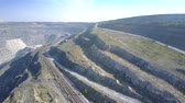 pit mine : aerial motion over tracks and railway on asbestos pit hills Stock Footage