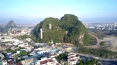 aerial view single green hill with temple among city
