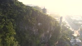 elevator to pagoda on forestry hill at city against sunlight 動画素材