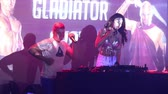 girl dj in silver top dances and plays modern music Vídeos