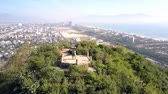 aerial view couple stands on hill top observation deck 動画素材