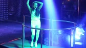 NHA TRANGVIETNAM - JULY 12 2015: Pretty Asian girl pop singer star in lacy top sings popular song in projector lights on nightclub podium on July 12 in Nha Trang Stok Video