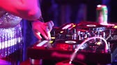 NHA TRANGVIETNAM - JULY 25 2015: Closeup girl dj hand with tattoo moves levers on music mixer console playing music under flashing lights in nightclub on July 25 in Nha Trang Vidéos Libres De Droits
